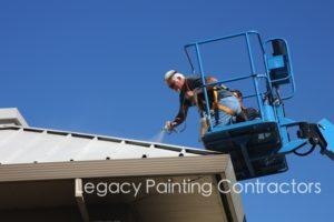 Spray painting a metal roof